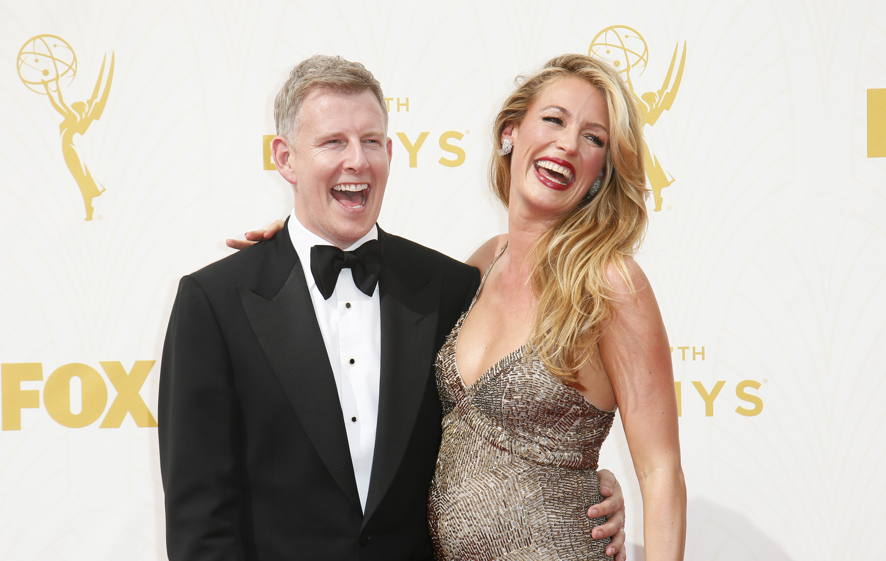Patrick Kielty, left, and Cat Deeley arrive at the 67th Primetime Emmy Awards on Sunday, Sept. 20, 2015, at the Microsoft Theater in Los Angeles. (Photo by Danny Moloshok/Invision for the Television Academy/AP Images)