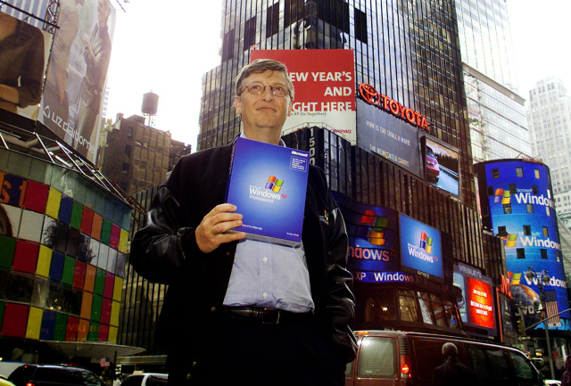 Bill Gates, Chairman and Chief Software Architect of Microsoft holds a copy of Microsoft's Windows XP in New York's Times Square October 25, 2001. Microsoft held a launch event for the new operating system in a near by theater. (Photo by Jeff Christensen/WireImage)