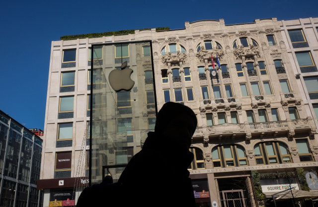 Silhouette of a passerby in front of the Apple Store in Liberty Square in Milan, Italy, on march 04 2020 (Photo by Mairo Cinquetti/NurPhoto via Getty Images)