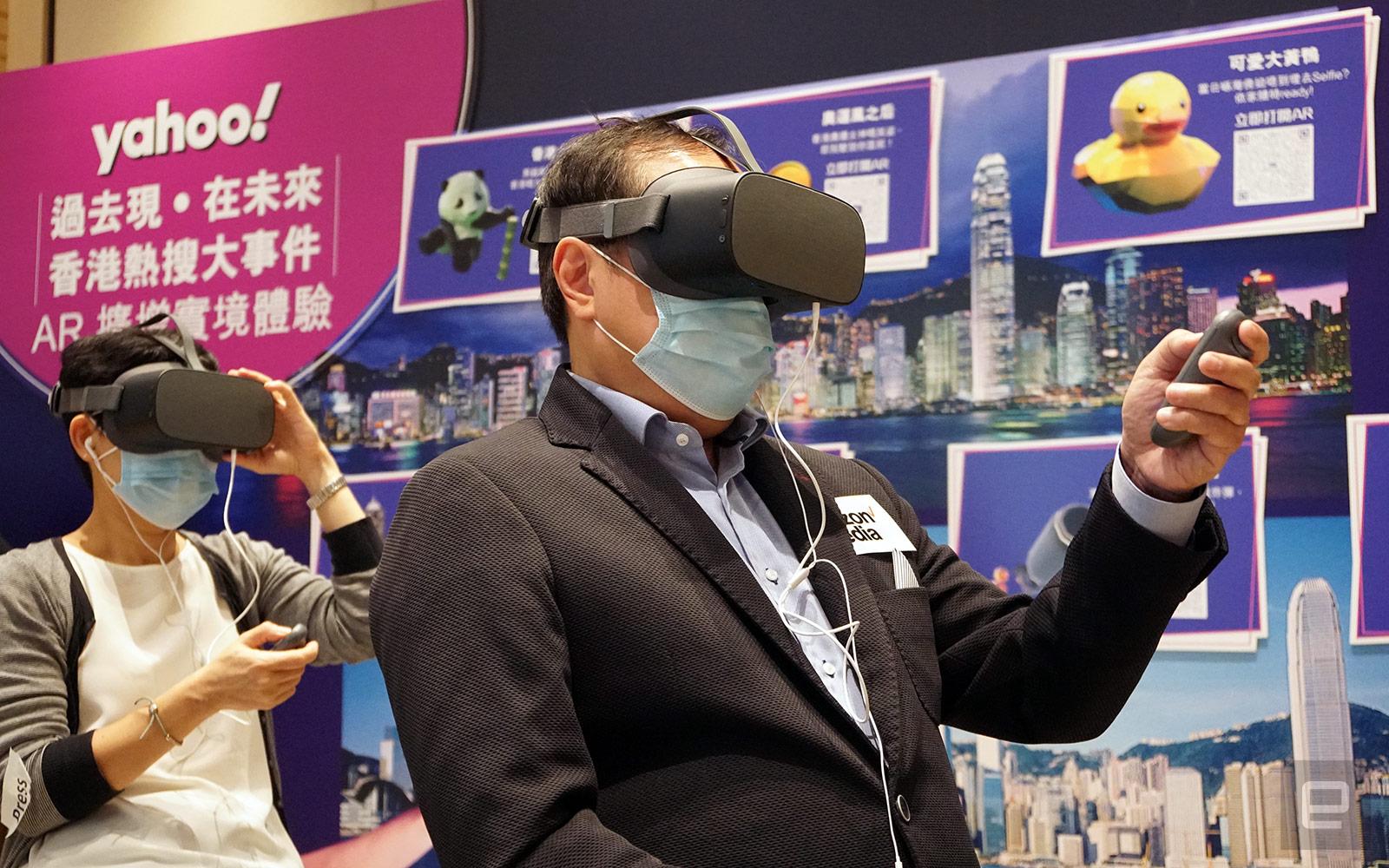 Verizon Media Co-head of APAC Rico Chan using a Pico G2 4K VR headset to visit an Engage virtual venue.