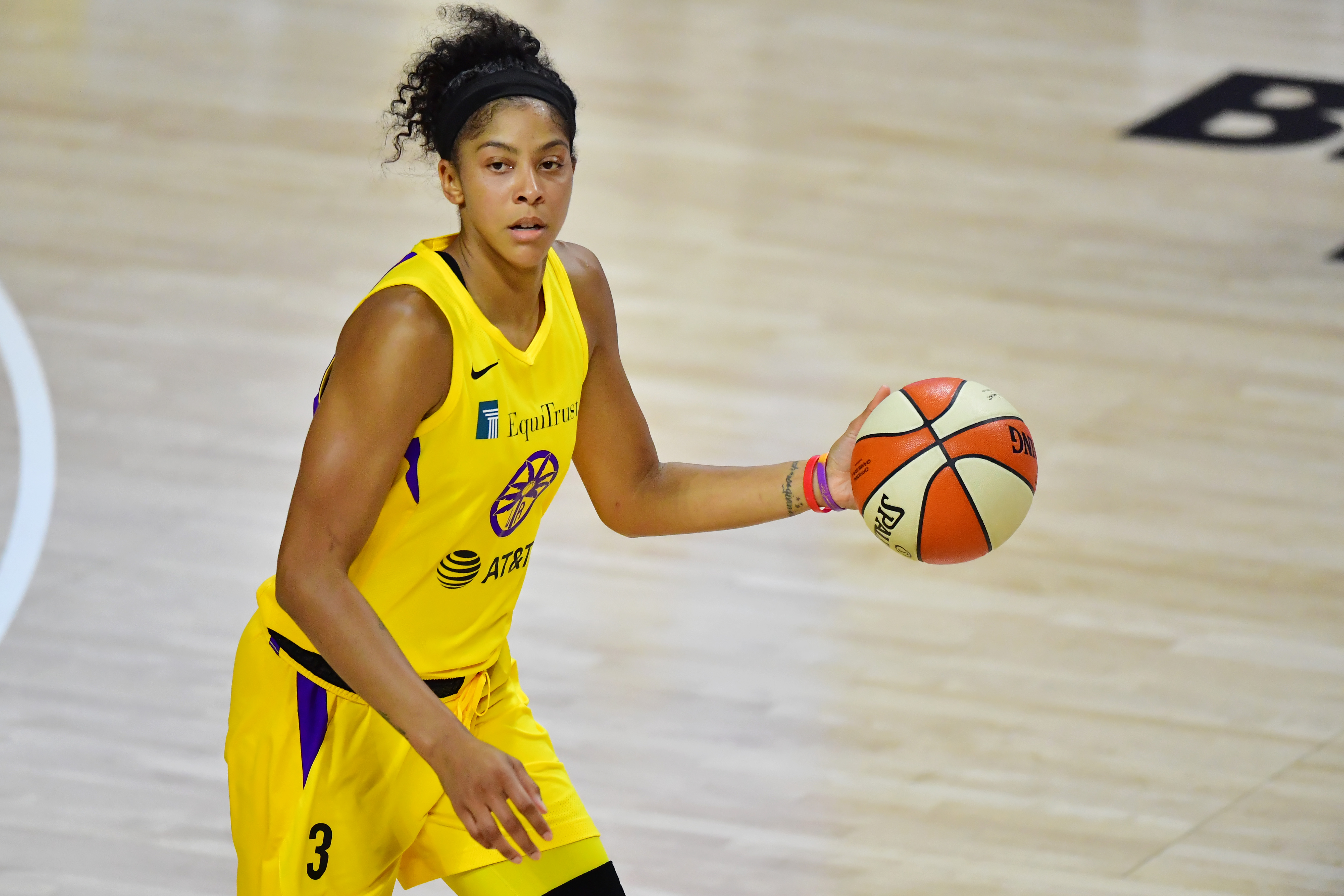Candace Parker, with ball, on the court.