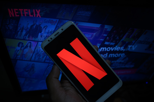 In this photo illustration, the logo of Netflix is displayed on a laptop screen and on a smart phone screen in Tehatta, Nadia, West Bengal, India on October 13, 2020.  (Photo Illustration by Soumyabrata Roy/NurPhoto via Getty Images)