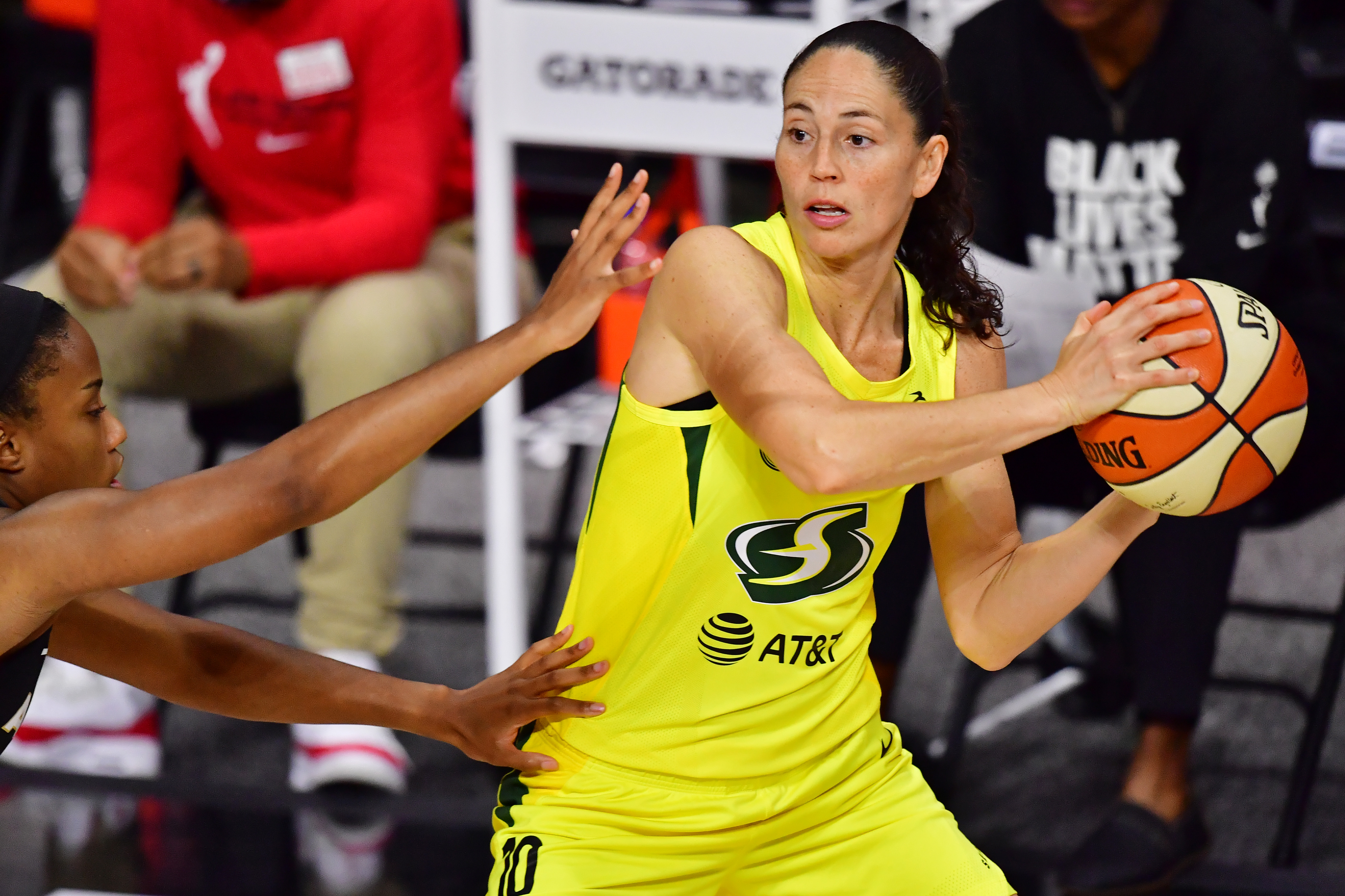 PALMETTO, FLORIDA - OCTOBER 02: Sue Bird #10 of the Seattle Storm looks to pass the ball around Lindsay Allen #15 of the Las Vegas Aces during the first half of Game 1 of the WNBA Finals at Feld Entertainment Center on October 02, 2020 in Palmetto, Florida. NOTE TO USER: User expressly acknowledges and agrees that, by downloading and or using this photograph, User is consenting to the terms and conditions of the Getty Images License Agreement. (Photo by Julio Aguilar/Getty Images)