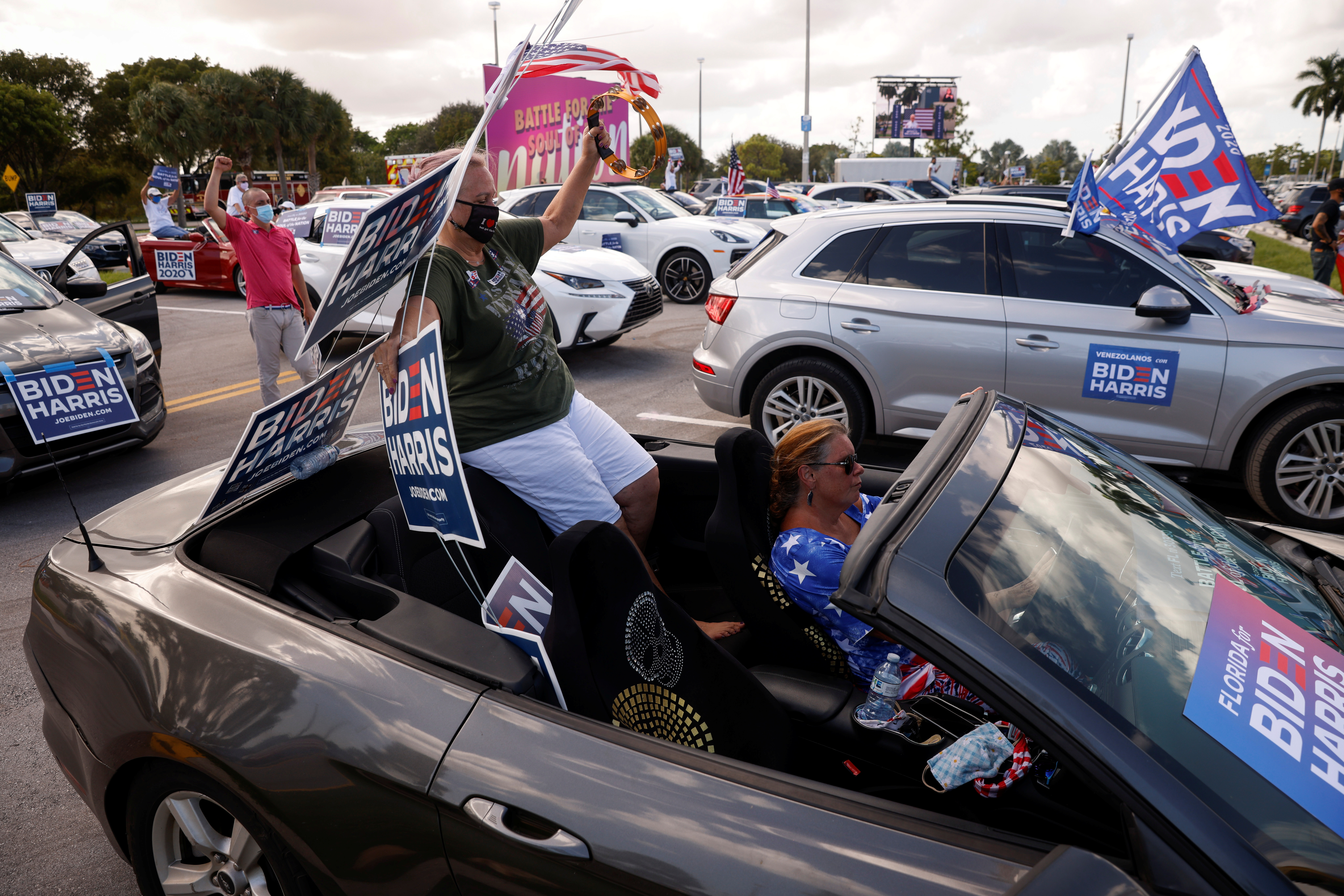 Supporters of the democratic U.S. presidential nominee and former Vice President Joe Biden are seen at a drive-in, at Get Out the Vote campaign stop in Coconut Creek, Florida, U.S., October 29, 2020. (Brian Snyder/Reuters)