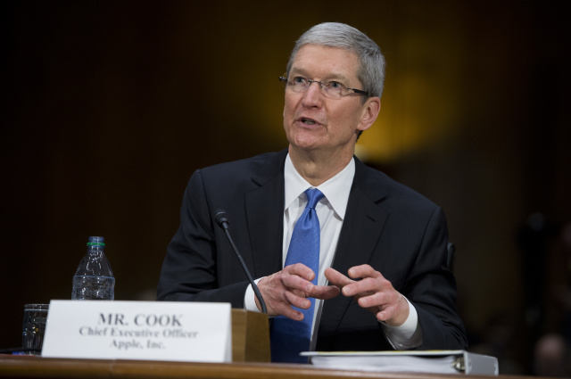 """UNITED STATES - MAY 21:  Tim Cook, CEO of Apple, testifies during a Senate Homeland Security and Governmental Affairs Subcommittee on Investigations in Dirksen Building titled """"Offshore Profit Shifting and the U.S. Tax Code - Part 2."""" Cook and other Apple officials were on hand to explain the company's filings after the Subcommittee accused Apple of tax avoidance. (Photo By Tom Williams/CQ Roll Call)"""