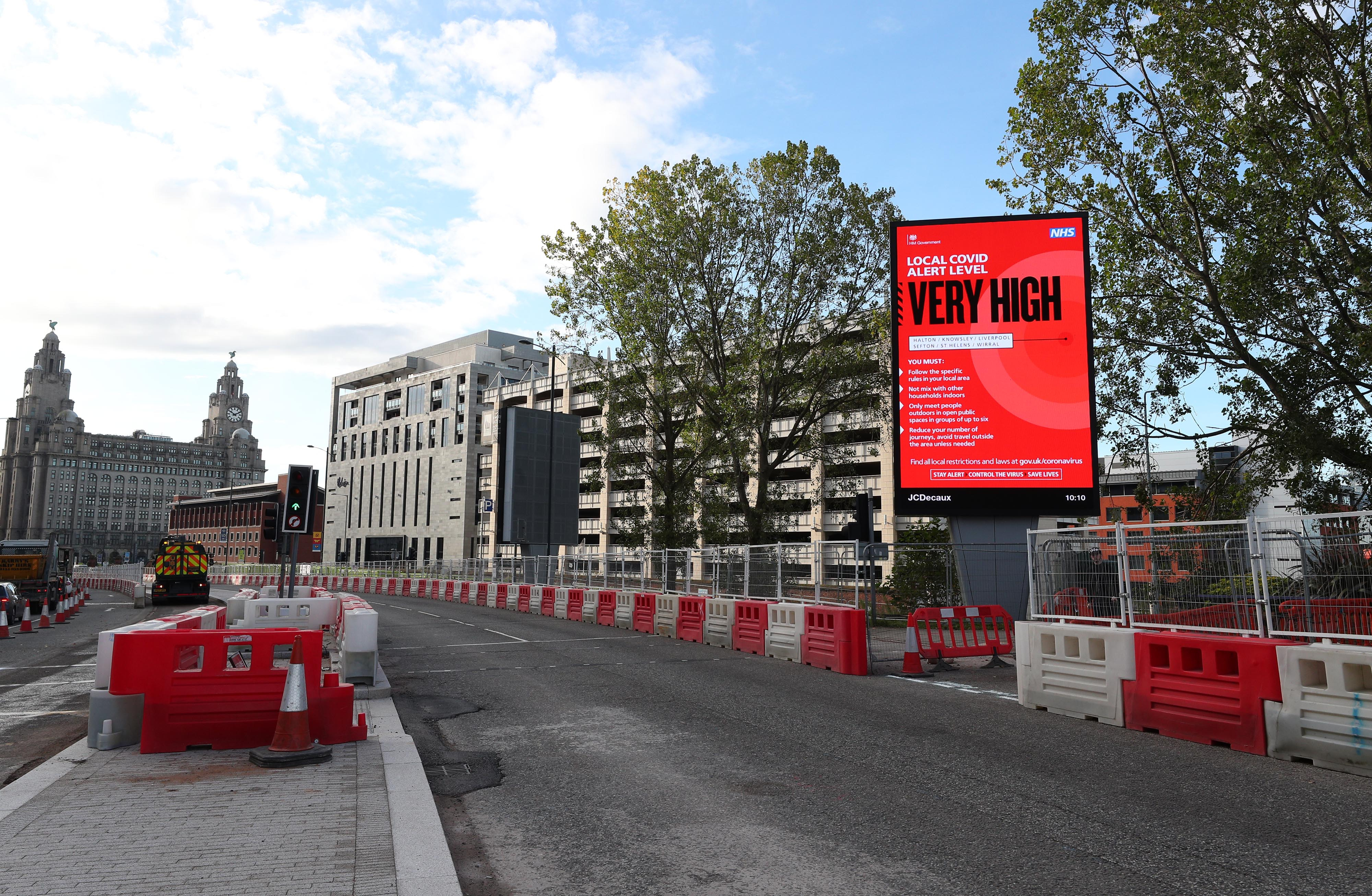 A Covid alert level sign in Liverpool after Prime Minister Boris Johnson set out a new three-tier system of alert levels for England following rising coronavirus cases and hospital admissions.