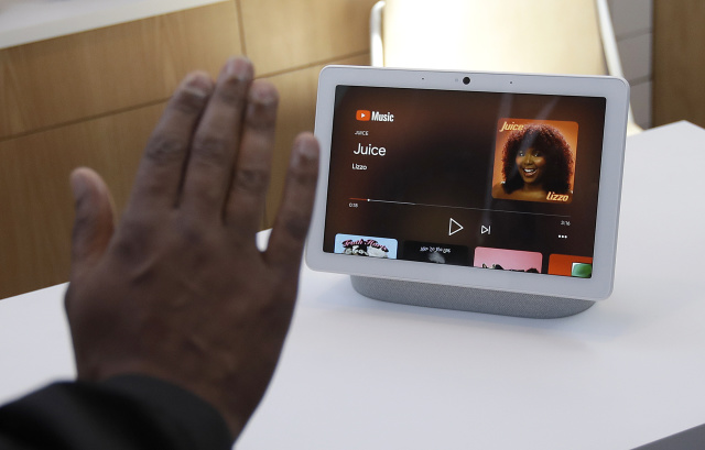 Google's Kayitta Johnson gives a demonstration of the Nest Hub Max by putting up his hand to control the device at the Google I/O conference in Mountain View, Calif., Tuesday, May 7, 2019. (AP Photo/Jeff Chiu)