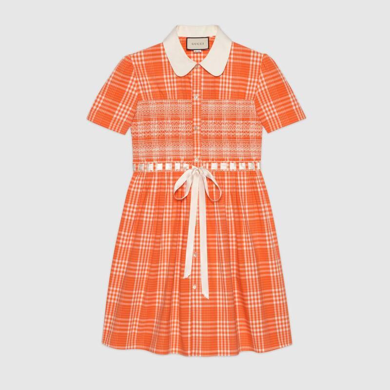 The orange tartan design features a satin bow detail. (Gucci)