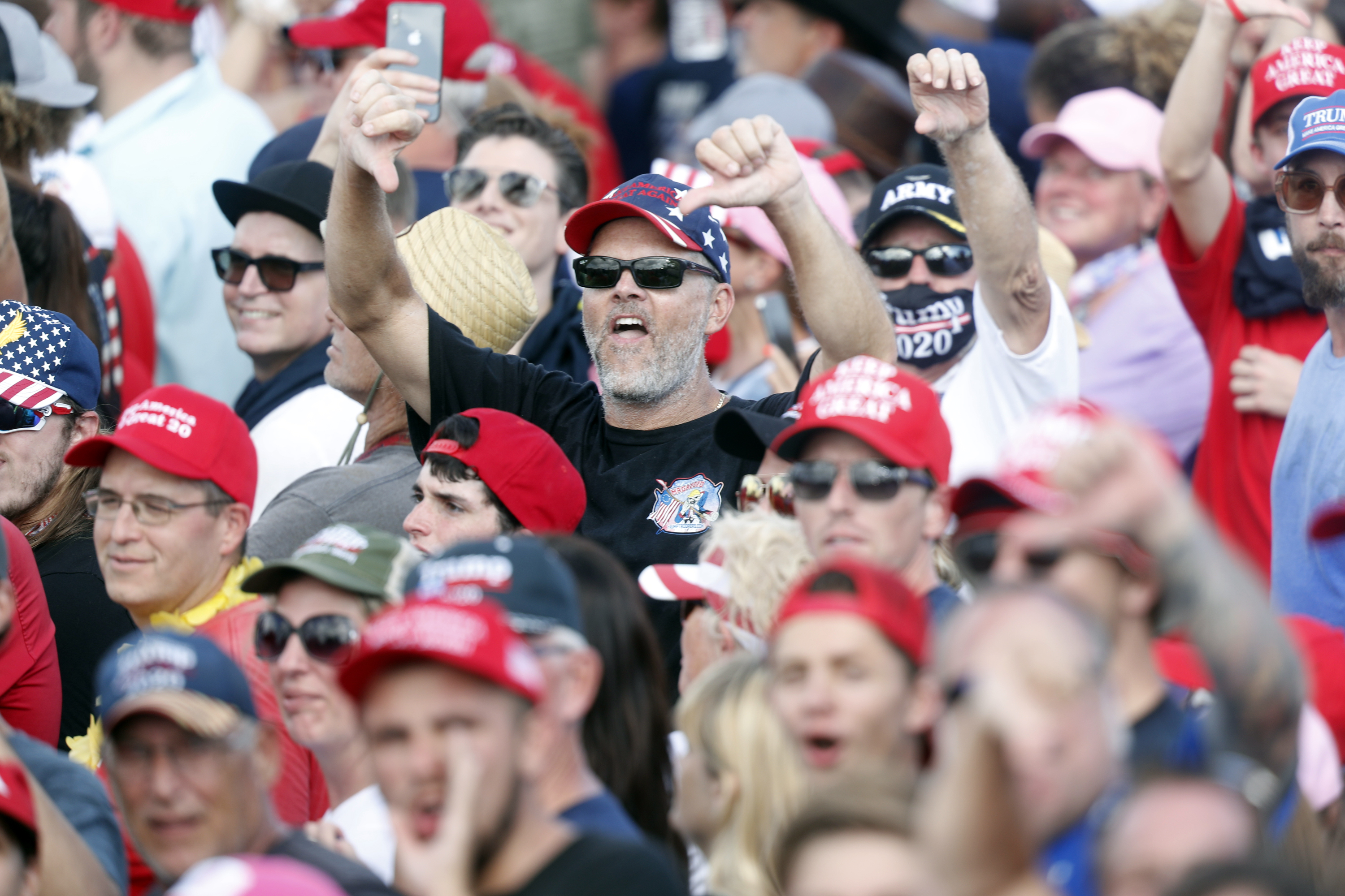 """Supporters of President Donald Trump show their disdain shouting """"CNN sucks"""" during his campaign speech just four days before Election Day outside of Raymond James Stadium on October 29, 2020 in Tampa, Florida. (Octavio Jones/Getty Images)"""
