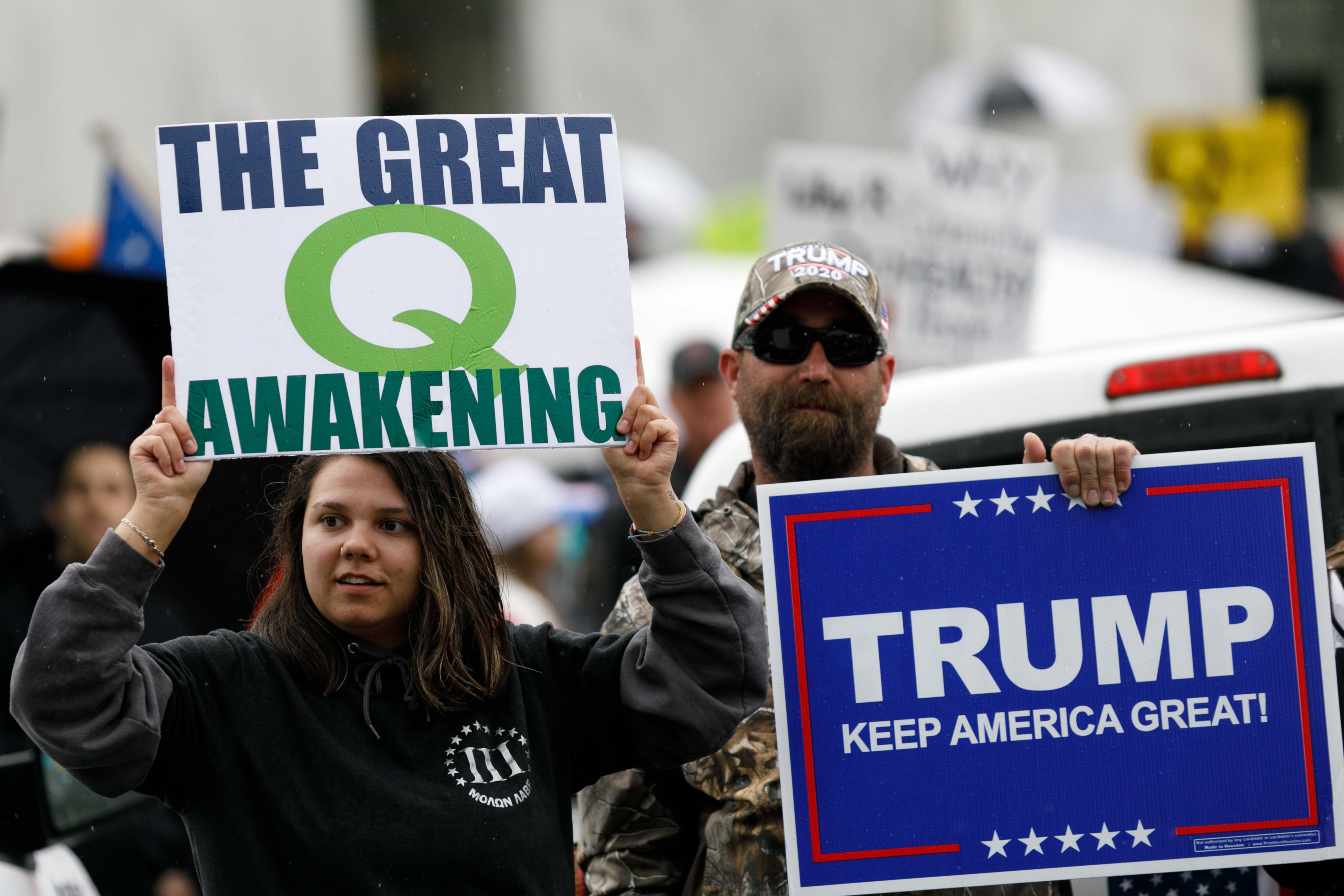 Q-Anon conspiracy theorists hold signs during the protest at the State Capitol in Salem, Oregon, United States on May 2, 2020. (John Rudoff/Anadolu Agency via Getty Images)