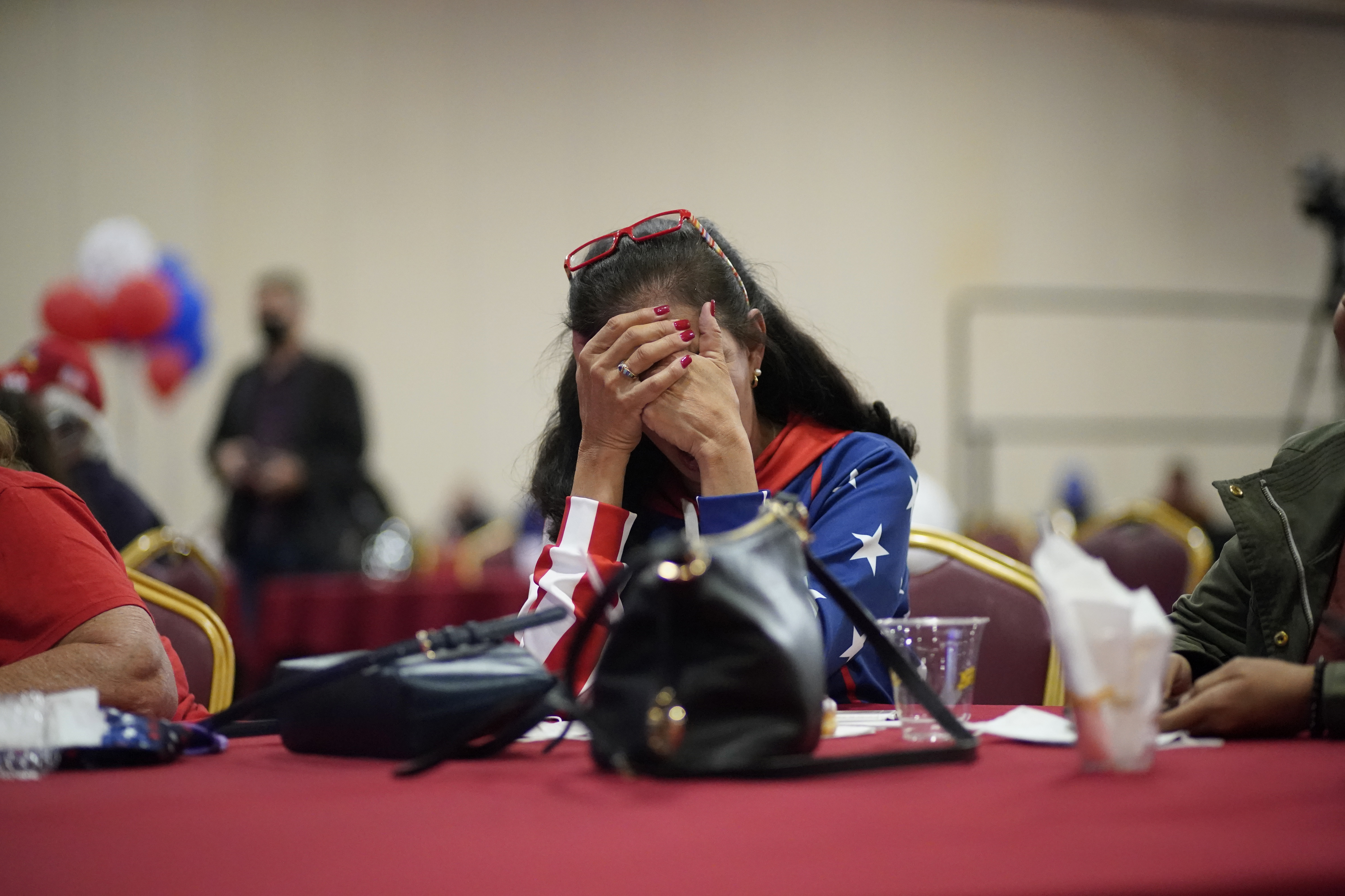 President Donald Trump supporter Loretta Oakes reacts while watching returns in favor of Democratic presidential candidate former Vice President Joe Biden, at a Republican election-night watch party, Tuesday, Nov. 3, 2020, in Las Vegas. (John Locher/AP)