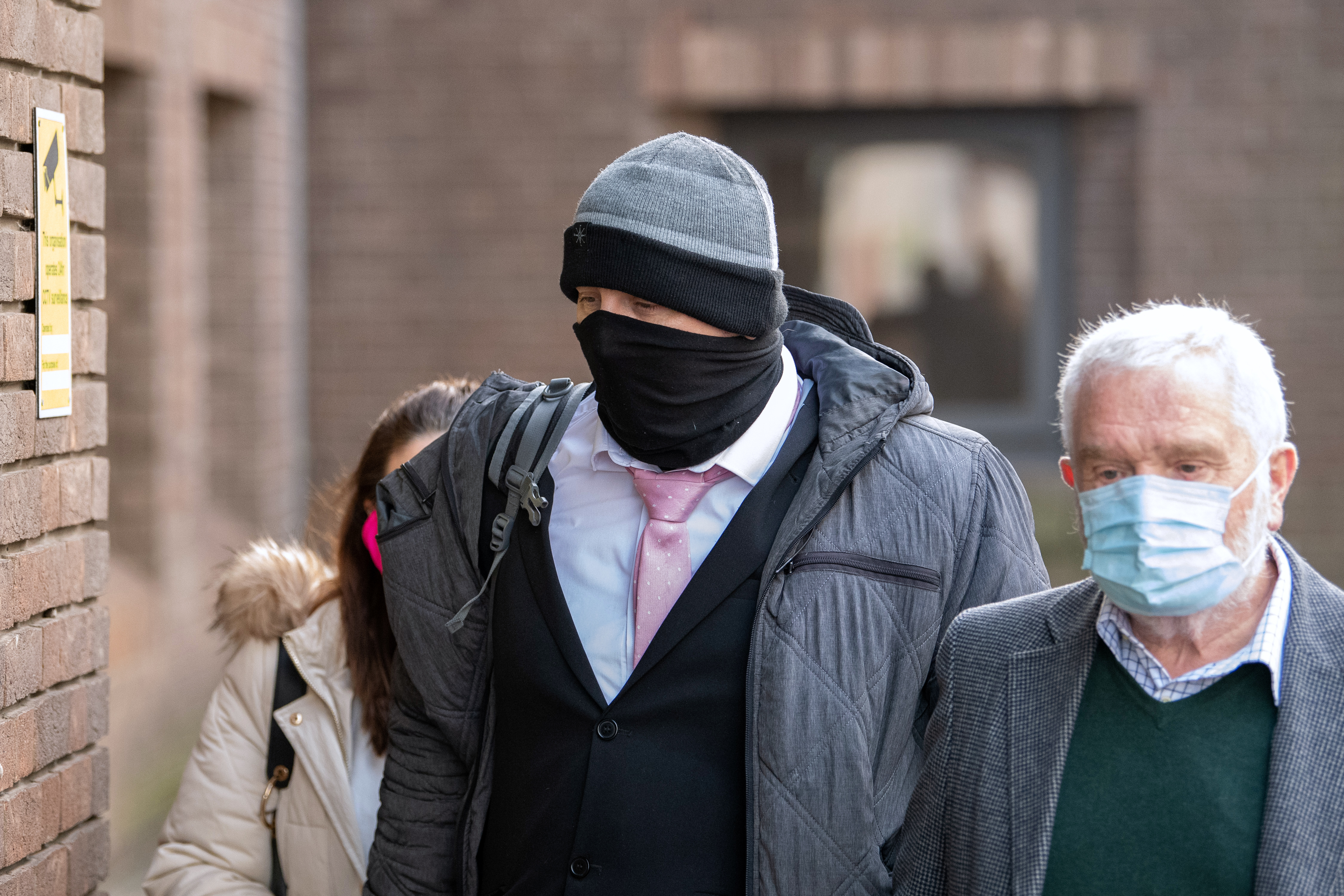 John Doak, 37, (centre) arrives at Chelmsford Crown Court in Essex for sentencing. (PA Images)