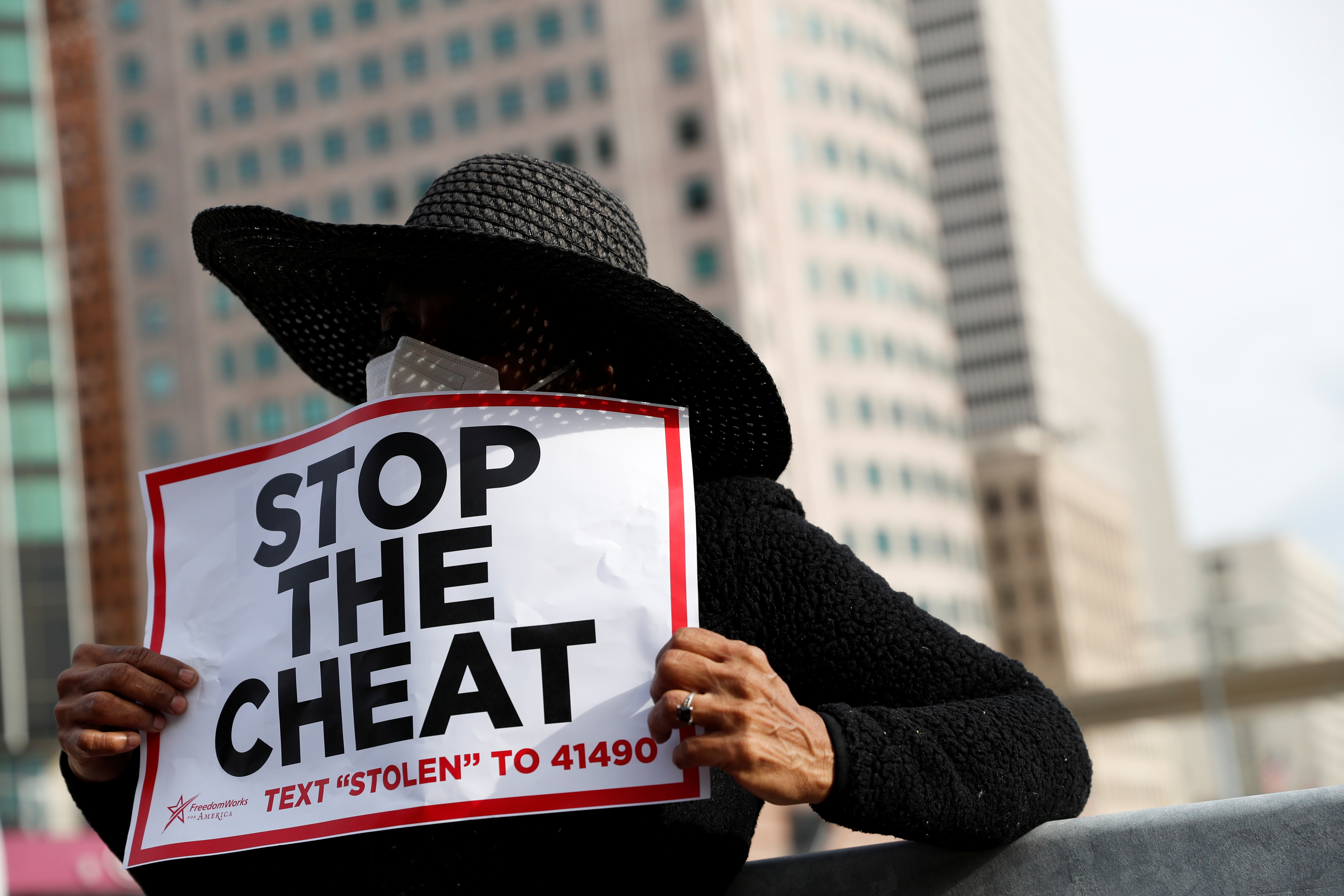 A demonstrator hols a sign as votes continue to be counted following the 2020 U.S. presidential election, in Detroit, Michigan on November 5, 2020.  (Shannon Stapleton/Reuters)