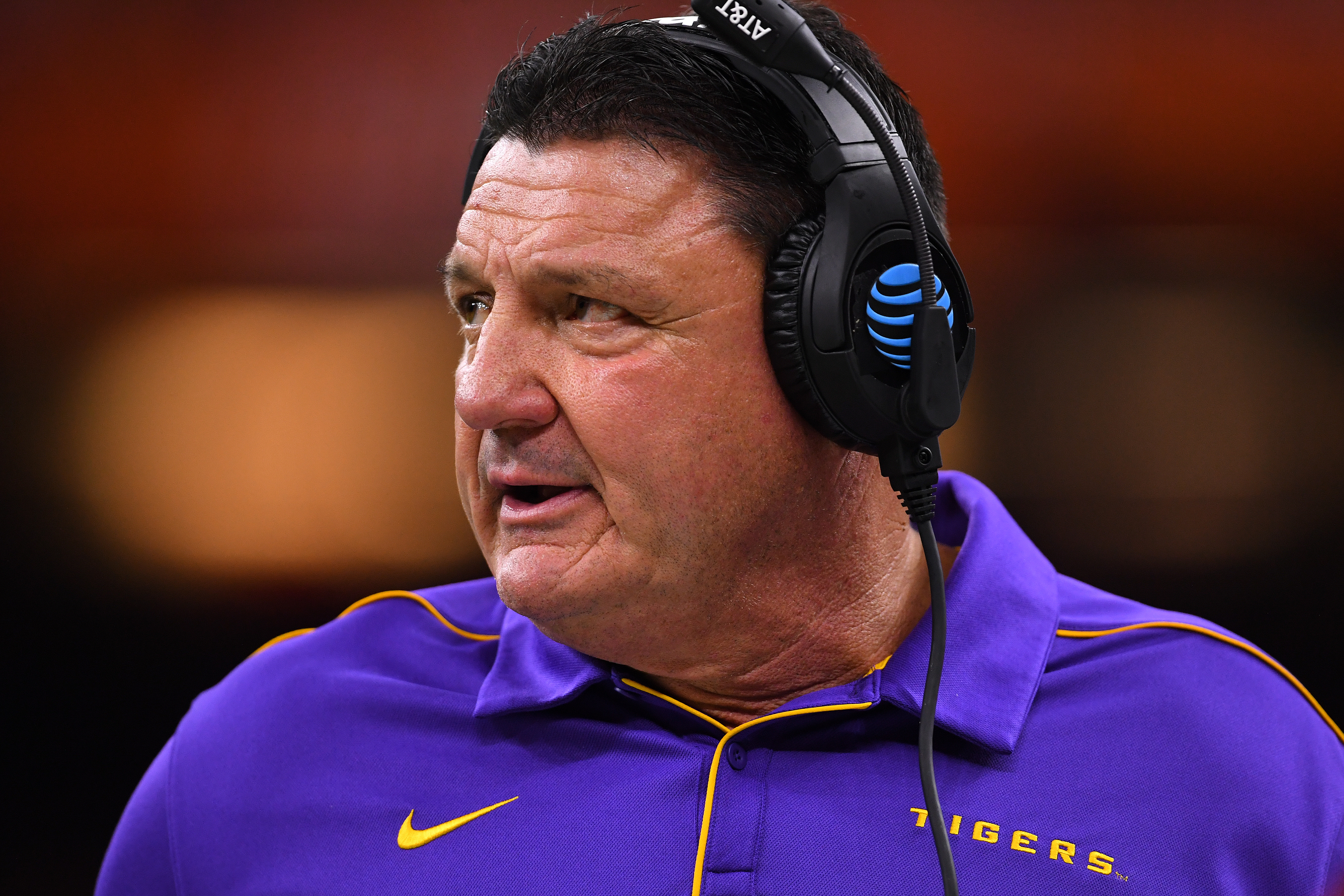 NEW ORLEANS, LA - JANUARY 13: Head Coach Ed Orgeron of the LSU Tigers coaches from the sidelines against the Clemson Tigers during the College Football Playoff National Championship held at the Mercedes-Benz Superdome on January 13, 2020 in New Orleans, Louisiana. (Photo by Jamie Schwaberow/Getty Images)