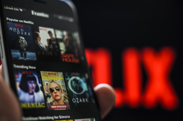 The Netflix application is seen on an Apple iPhone on October 1, 2018. Analysts predict new shows on the streaming service will bolster Netflixs position as leader of streaming content in 2019. (Photo by Jaap Arriens/NurPhoto)