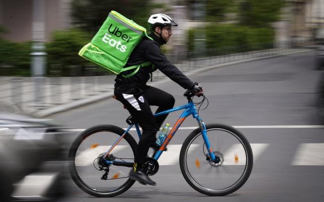An Uber Eats courier is seen in Bucharest, Romania on May 1, 2019. (Photo by Jaap Arriens/NurPhoto)