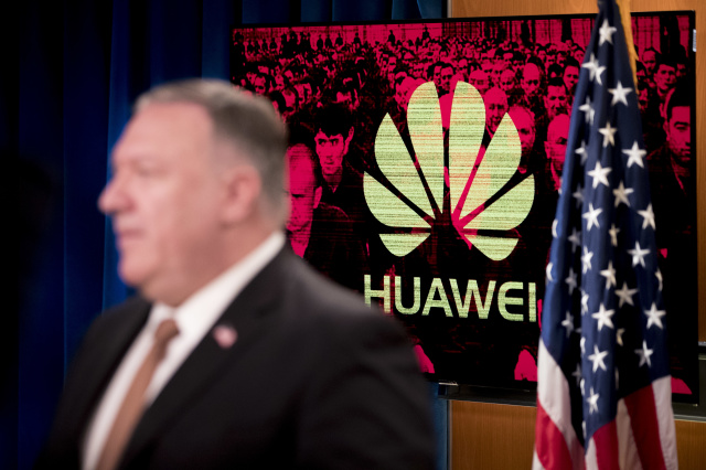 "A monitor displays the logo for Huawei behind Secretary of State Mike Pompeo as he speaks during a news conference at the State Department in Washington,DC on July 15, 2020. - US Secretary of State Mike Pompeo said Wednesday he will visit Britain and Denmark next week, days after London pleased Washington with a ban on Chinese telecom giant Huawei. ""I leave on Monday for a quick trip to the United Kingdom and Denmark, and I'm sure that the Chinese Communist Party and its threat to free peoples around the world will be high on top of that agenda,"" Pompeo told a news conference. (Photo by Andrew Harnik / POOL / AFP) (Photo by ANDREW HARNIK/POOL/AFP via Getty Images)"