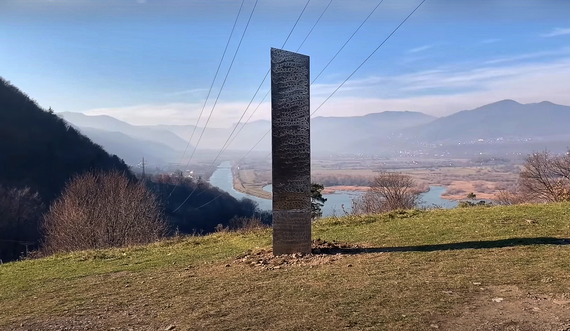 A mysterious metal monolith, similar to the one found in Utah, was discovered near an ancient Dacian fortress in Romania.