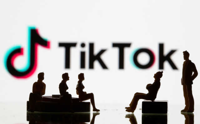 Small toy figures are seen in front of a Tiktok logo in this illustration taken, September 9, 2020. REUTERS/Dado Ruvic/Illustration - RC27VI9QJUCZ